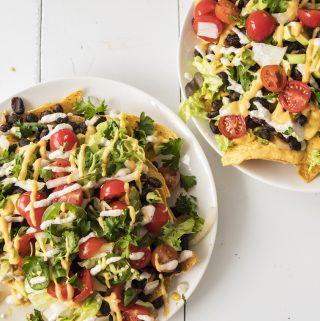Gluten free vegan black bean nachos with homemade queso